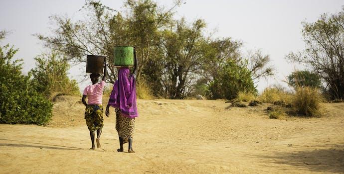 Women carrying water in Ghana