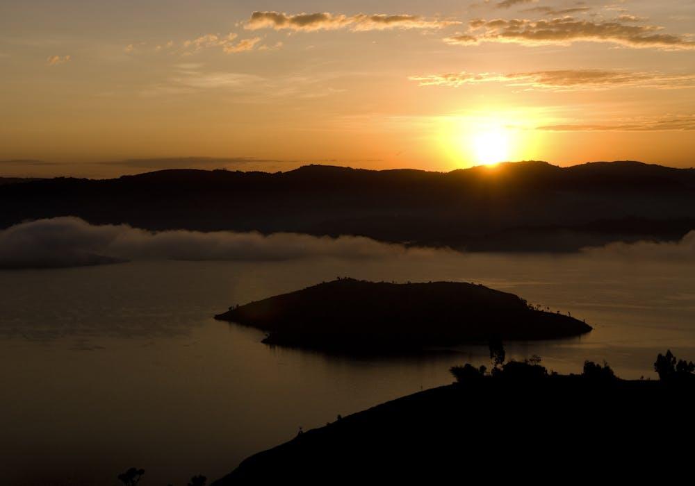 Sunrise over crater lake from Virunga Lodge, Rwanda