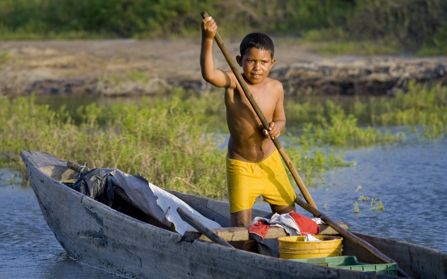 A local boy in a canoe near Santa Marta, Colombia