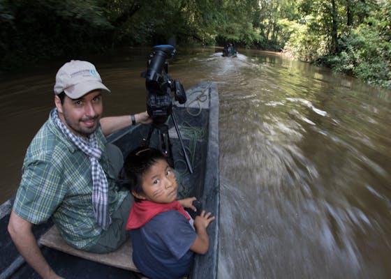 John Martin with a child in Ecuador