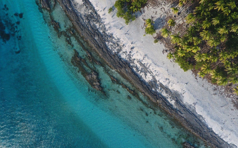 Aerial shot of a beach in the Lau Islands