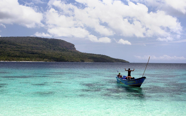 Local fishermen launch their boat at Valu Beach, in Nino Konis Santana National Park