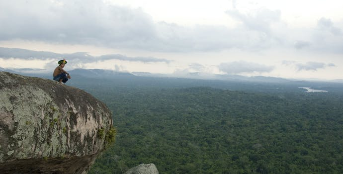 Kayapo man on top of the mountains with forest.