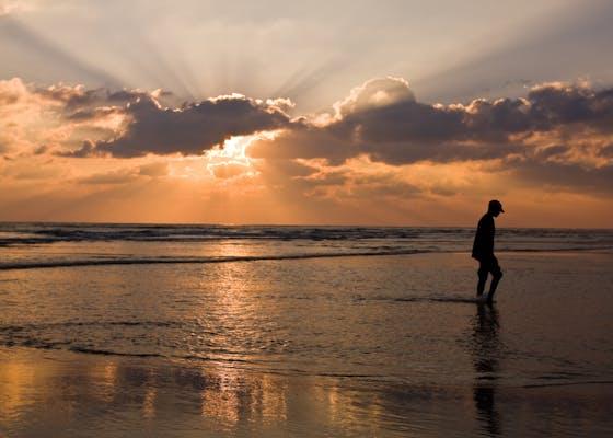 Man walking, sunrise in Mozambique