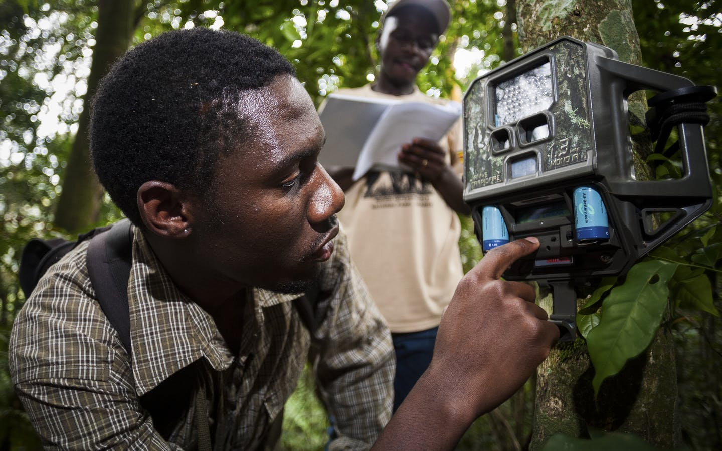 Badru Mugerwa and Lawrence Tumugabirwe set camera trap in Kenya