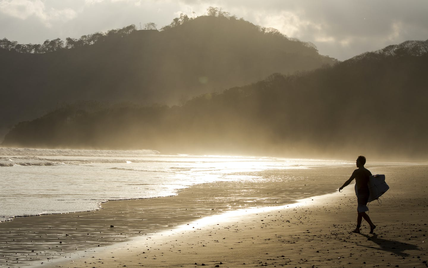 A foreign surfer enjoys the best of Costa Rica's ecotourism possibilities.