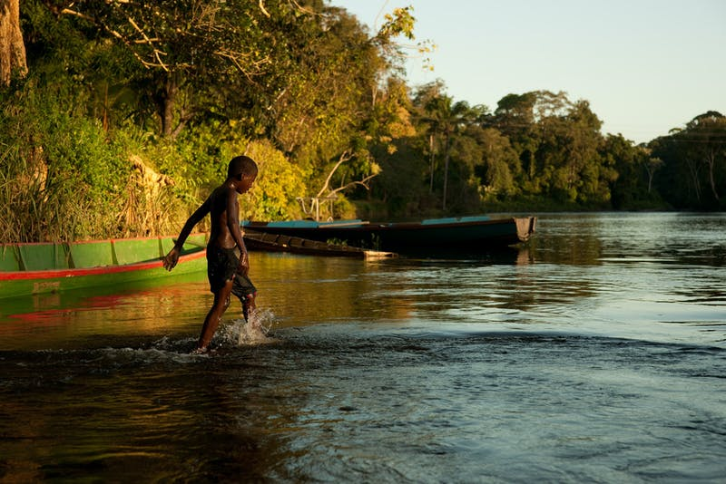 Boy wades through river