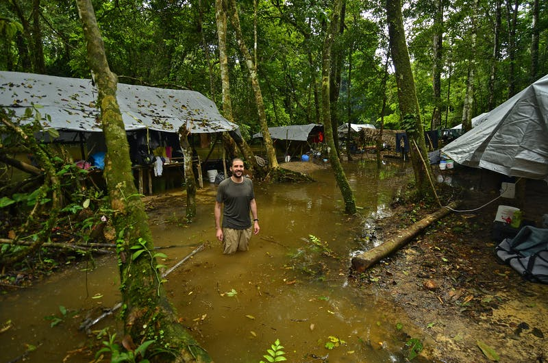 Unusually strong and long-lasting rain caused the Upper Palumeu River to flood its banks, completely inundating our camp and forcing the team to move sooner than planned. Here, RAP Director Trond Larsen stands in the middle of the formerly dry camp.