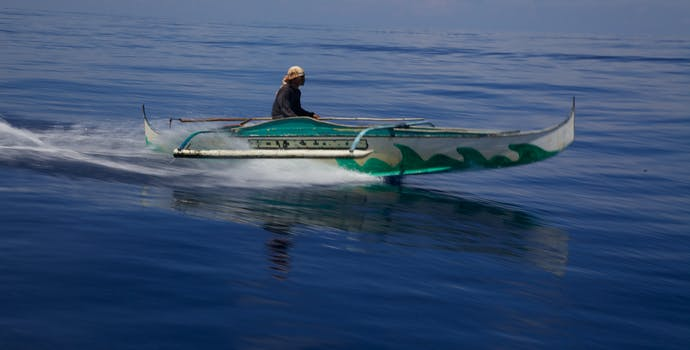 Riding a boat in the Turtle Island Protected Area in the Philippines