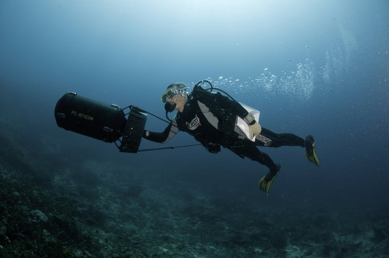 Dr. Gerry Allen uses an underwater propulsion device (scooter) to survey the reefs during a marine expedition to Halmahera, North Maluku Province.